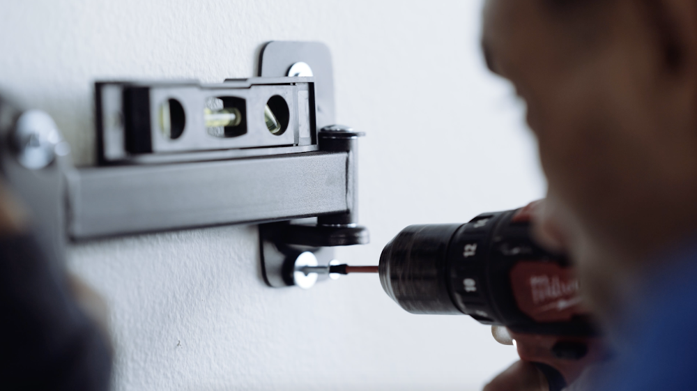 drilling screws into the wall