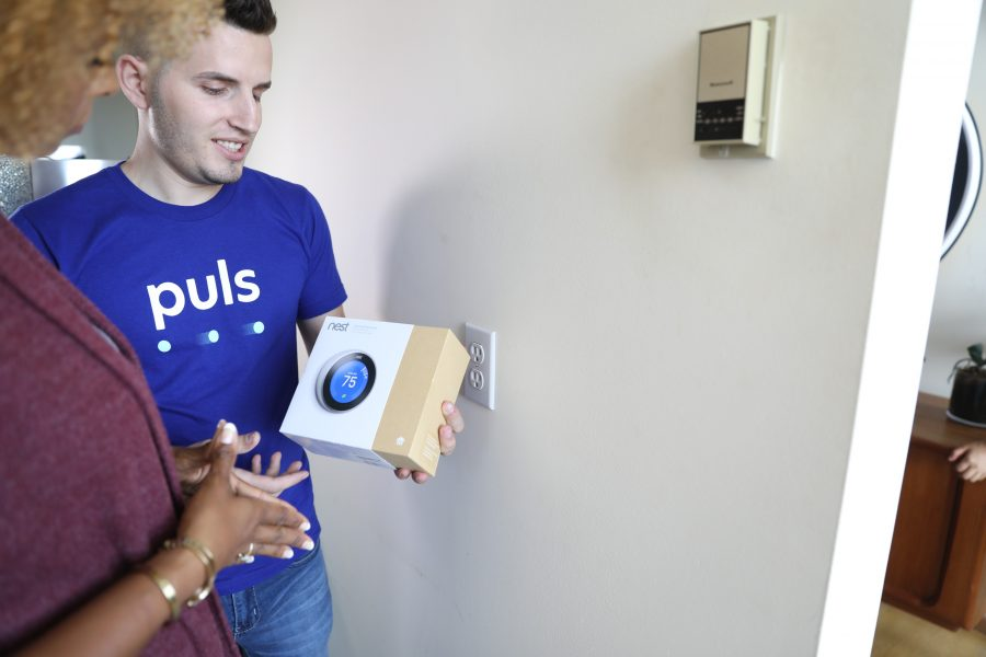 man showcasing the nest thermostat