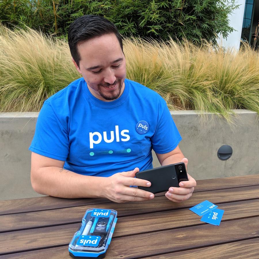 puls technician looking at pixel 2 phone