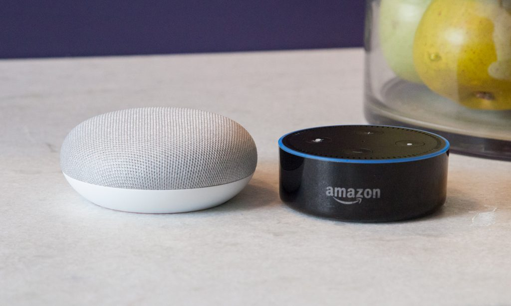 image of Google home mini and amazon echo dot side by side