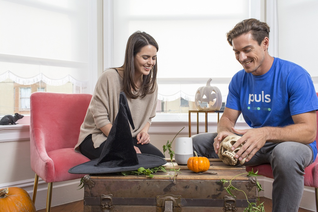 man and women using google home smart assistant