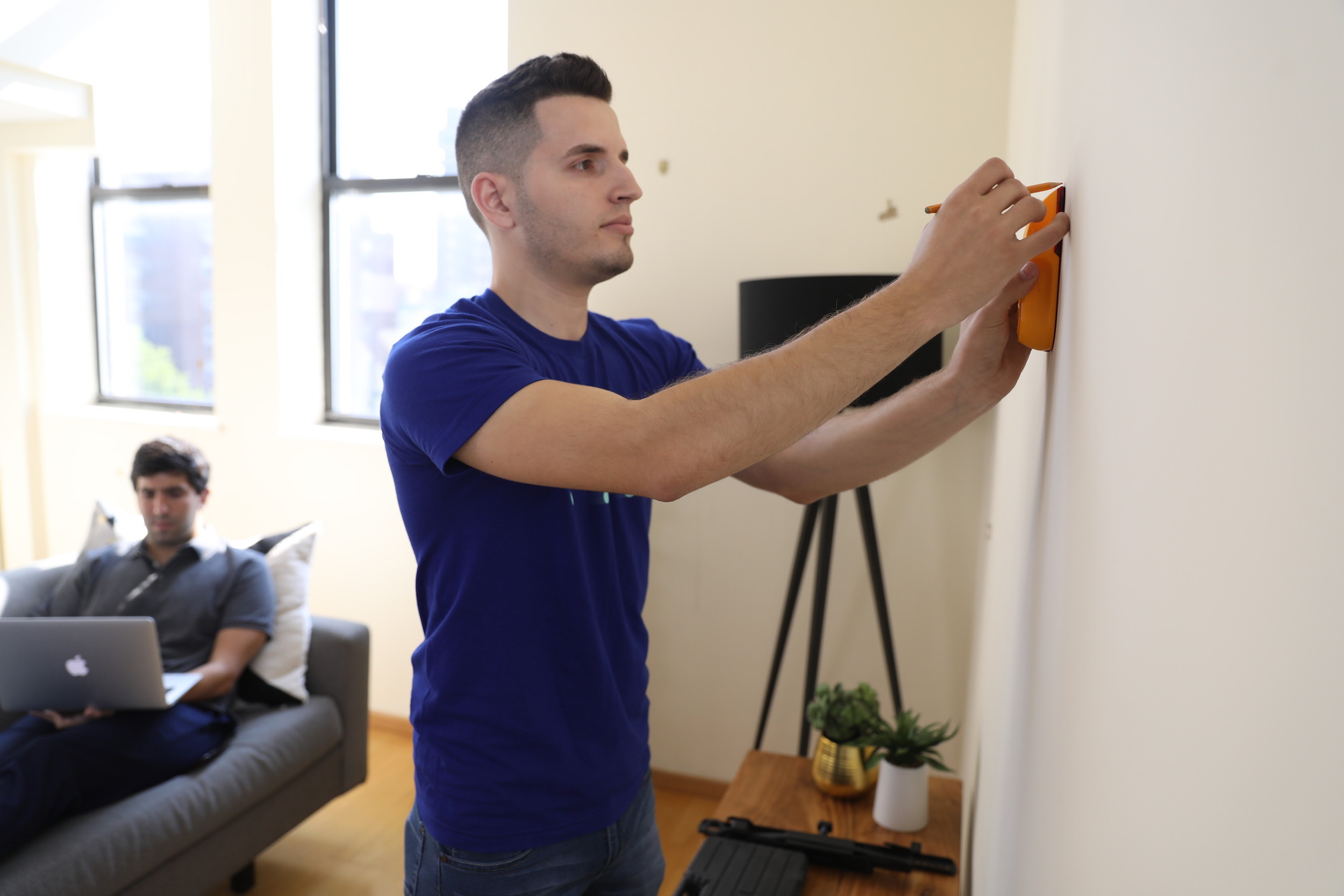 man planning where to hang tv wall mount