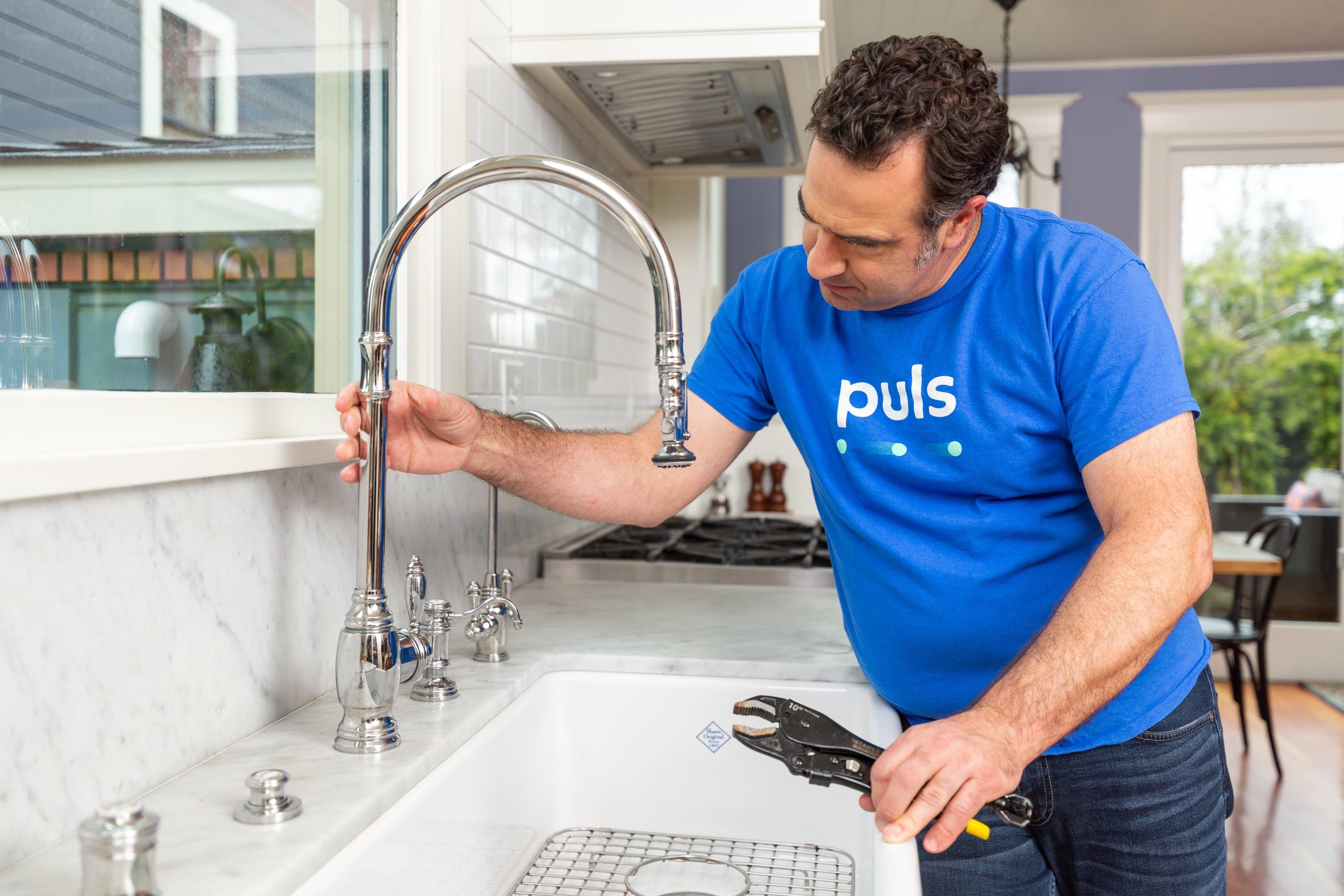 Puls plumbing technician in kitchen