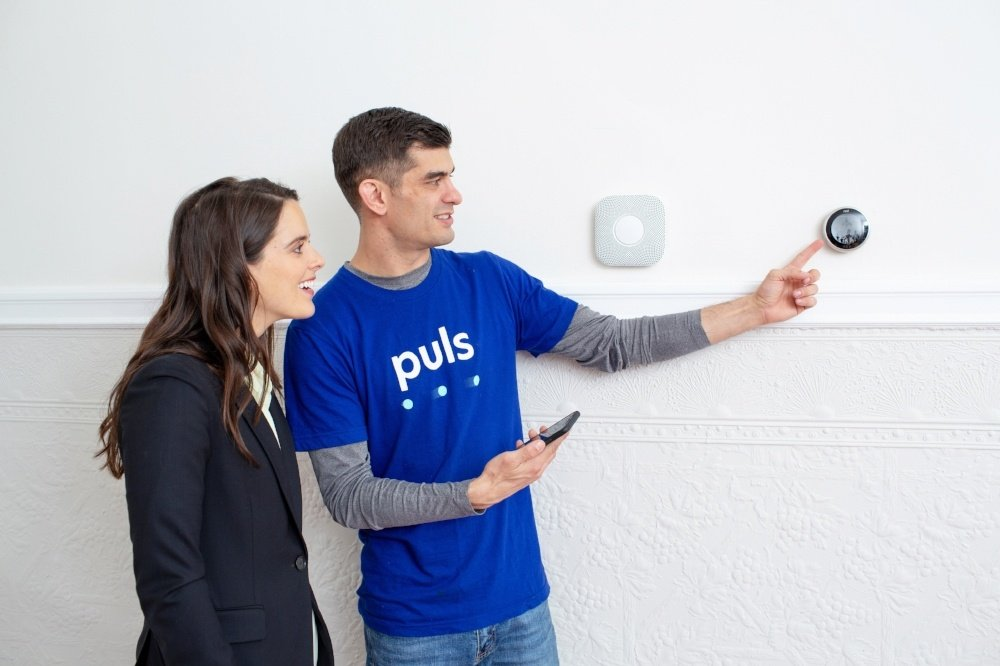 Puls technician installing nest thermostat