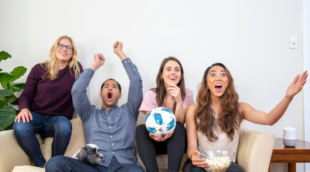 friends watching game together