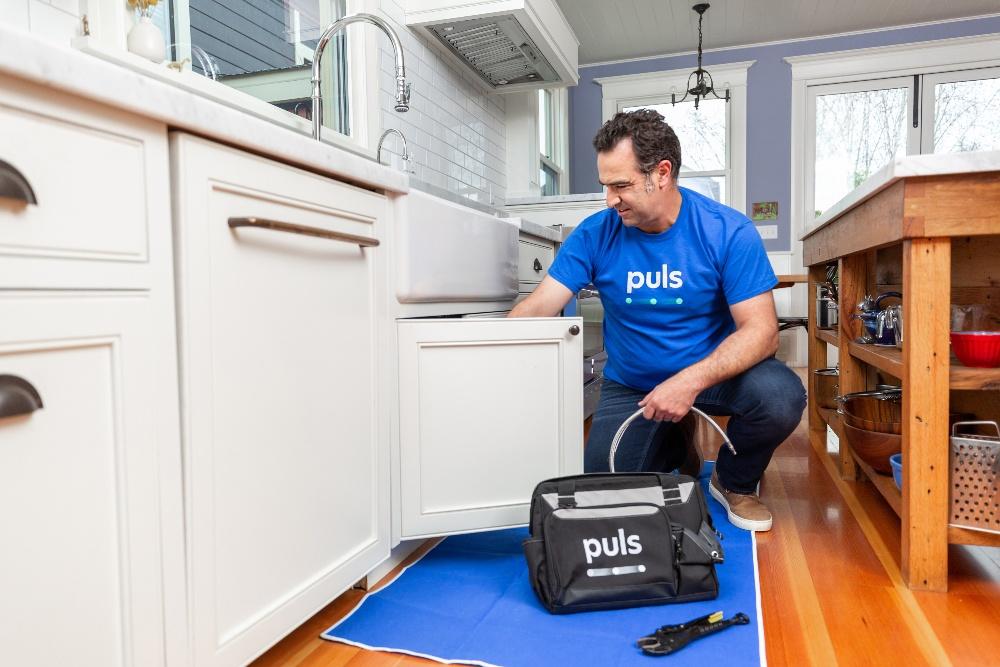 puls plumbing technician fixing clogged sink
