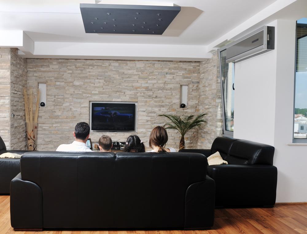 family watching mounted tv