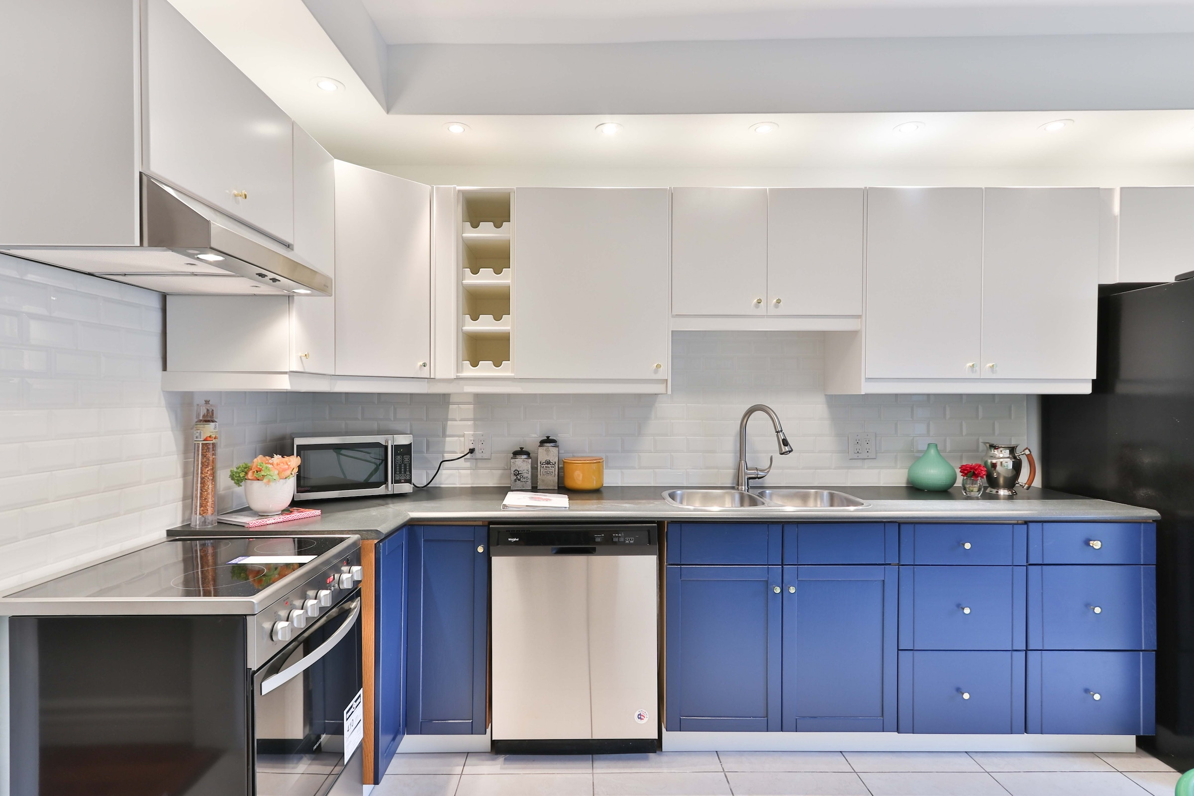 We're loving the two-toned kitchen look that's trending right now!