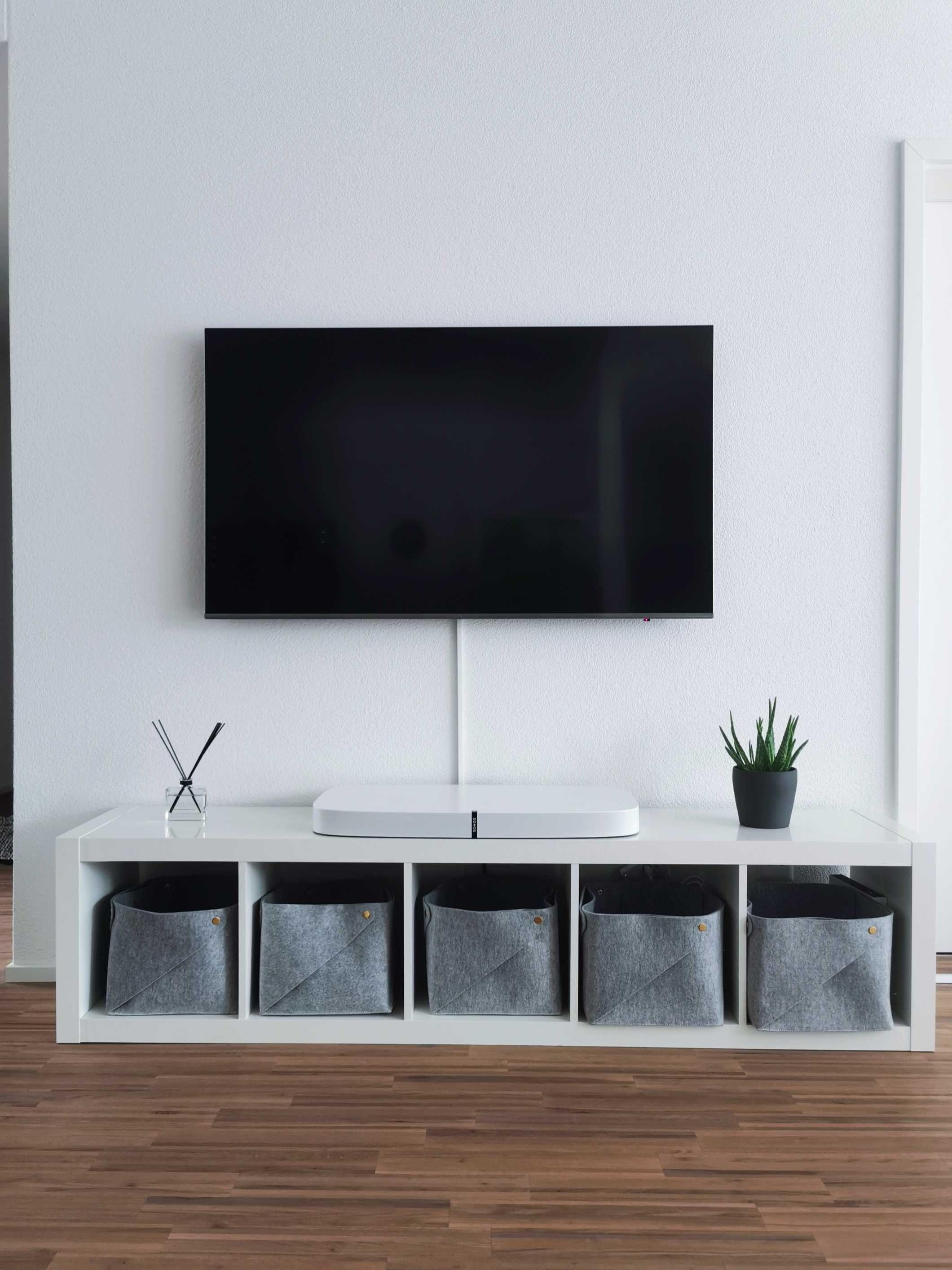 Store and display your favorite things with a TV mount vs stand.