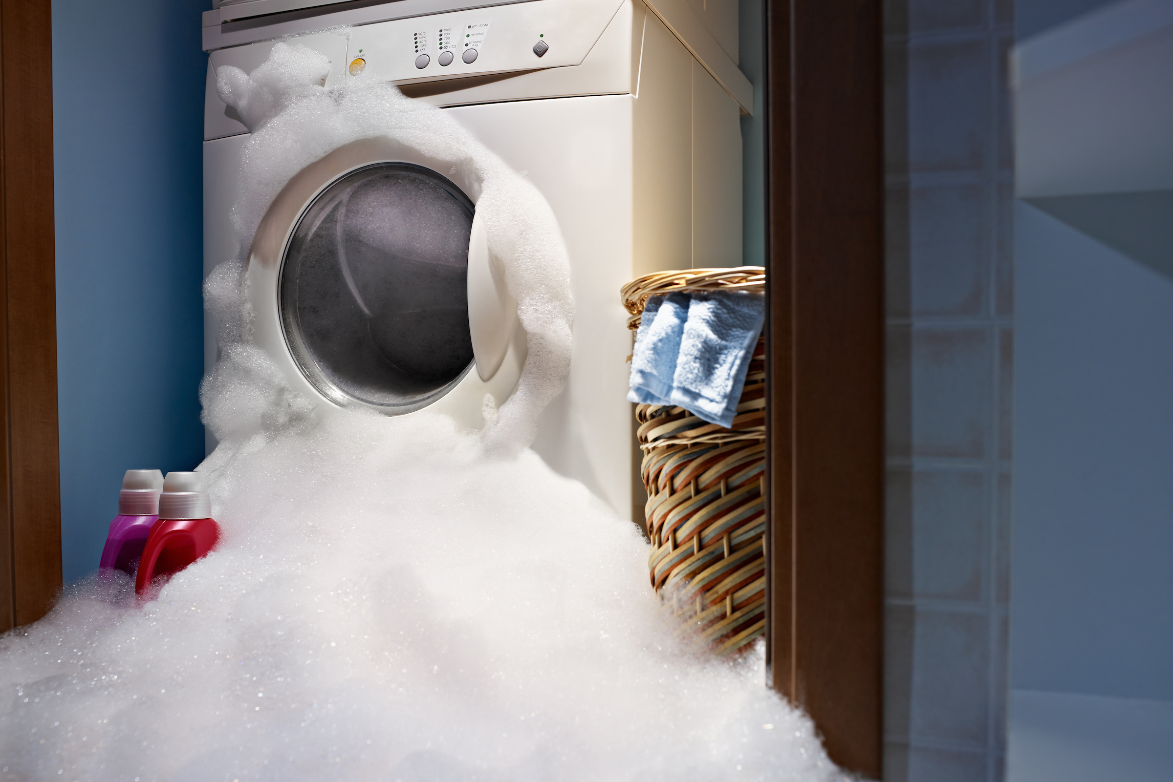Washing machine overflowing? Clean up the mess before you assess the damage.