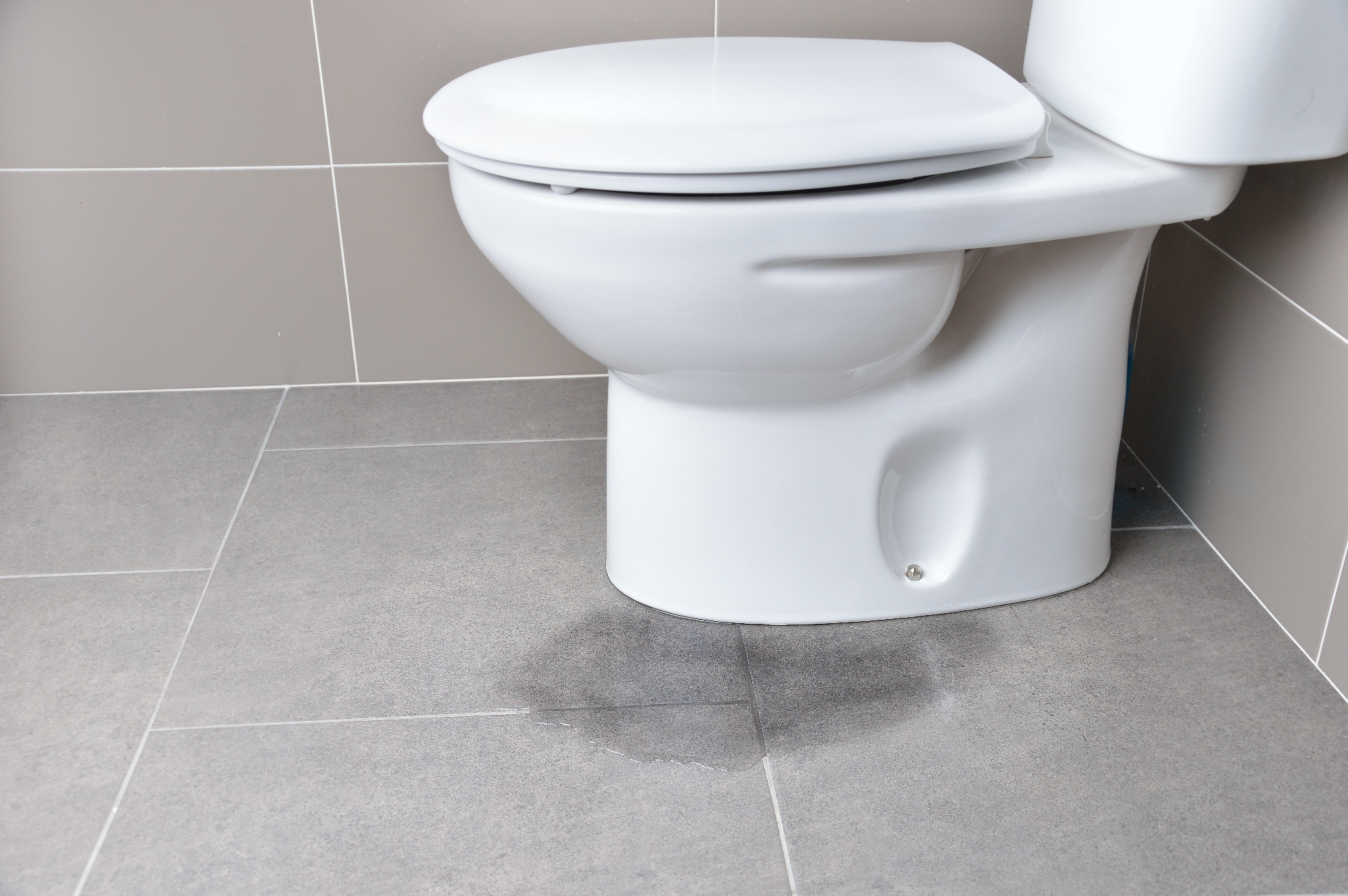 water leaking from middle of toilet