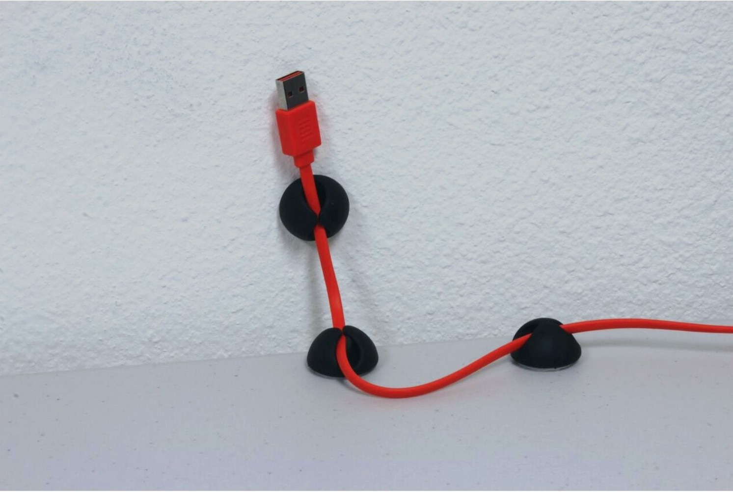 You can also hide tv wires with cable clips.